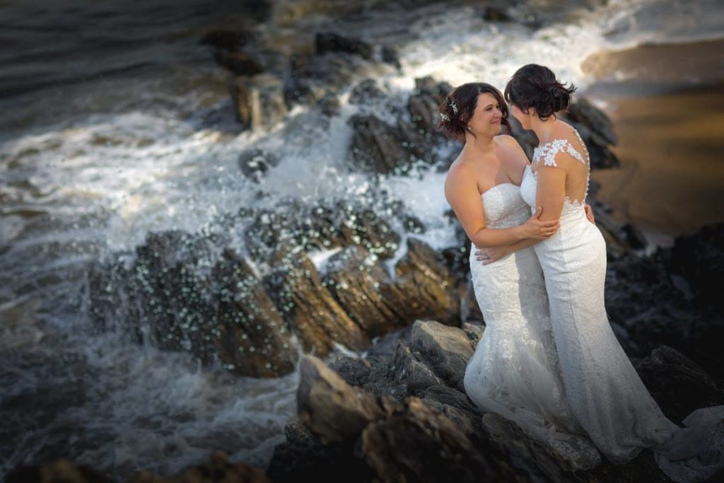 Two female brides on the beach at a same sex wedding in Cairns